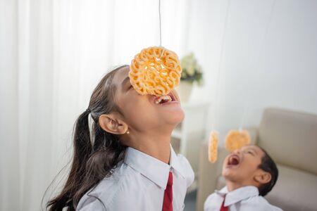 Children eating snacks in living room