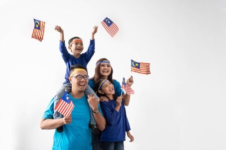 Malaysia family with attributes and flag celebrating Imagens