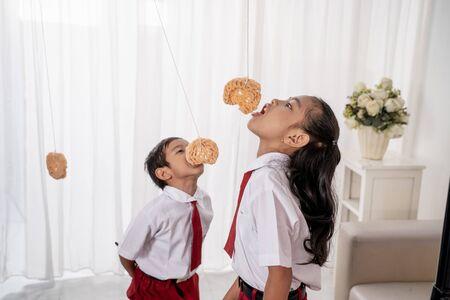 Children eating snacks in the living room