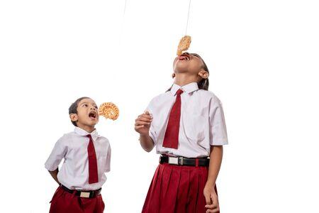 Kid eating snacks on white