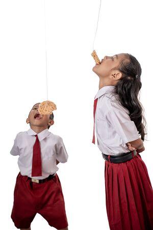 Children eating snacks on the white