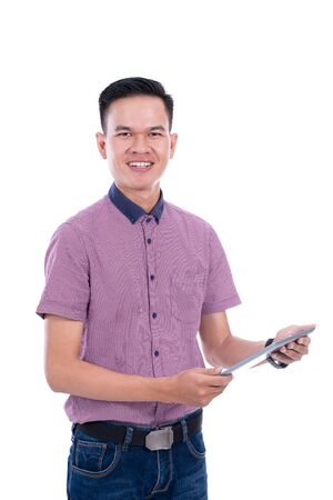 Young asian man in casual shirt using tablet
