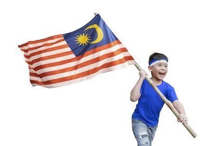 proud kid waving malaysian flag on independence day celebration isolated over white background Stock Photo