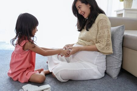 asian little girl choose baby shoes