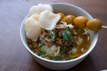 Delicious Indonesian food of bubur ayam with traditional side dishes Stock Photo - 131462021