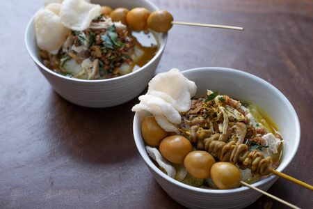 Delicious indonesian food of bubur ayam with traditional side dishes Stock Photo - 131462026
