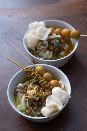 Delicious Indonesian food of bubur ayam with traditional side dishes