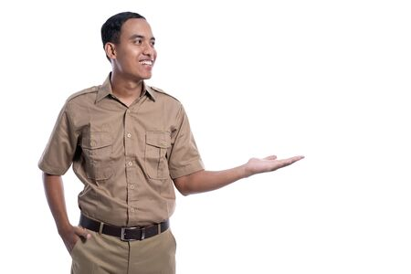 indonesian worker with khaki uniform presenting to blank copy space smiling