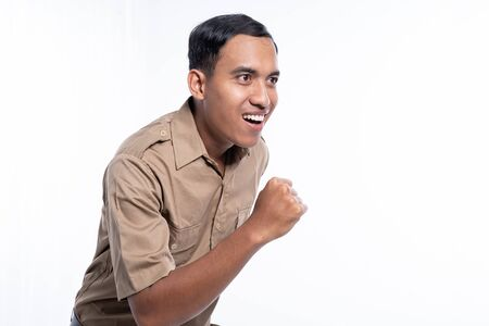 asian worker with brown uniform running isoalated over white Stock Photo