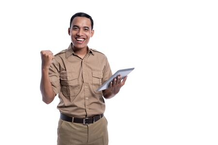 happy indonesian government worker using tabletp pc