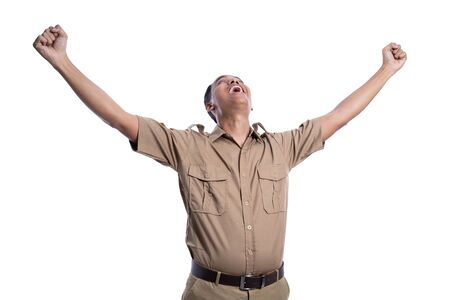 excited male worker wearing brown uniform raised his arm