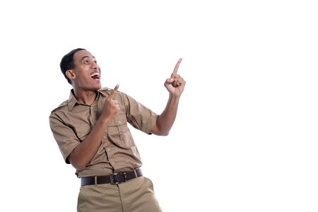 excited indonesia government worker with brown uniform pointing