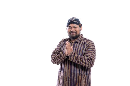 male with javanese traditional cloth lurik greeting