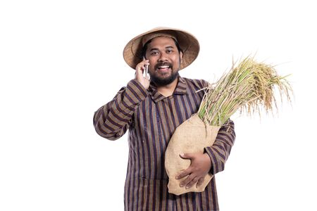 asian farmer using mobile phone isolated over white