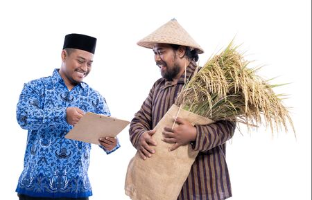 farmer and partner discussion while holding a bag of rice grain 스톡 콘텐츠