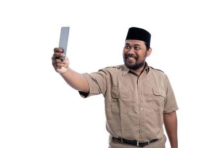 muslim worker of indonesia take selfie with smartphone