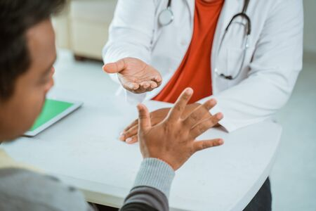 gesture of doctor asking for his payment to patient in clinic