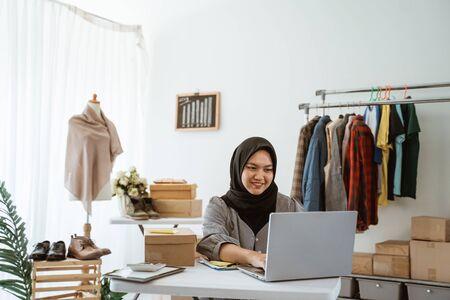 muslim businesswoman online ecommerce shop owner working in her office