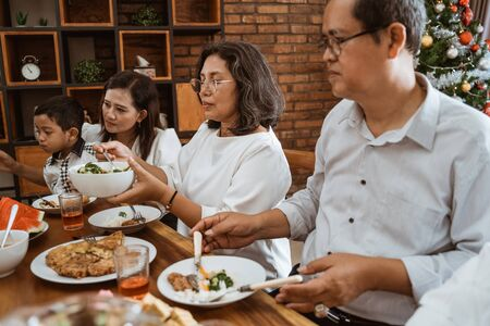 lunch with family on christmas day together Stock Photo