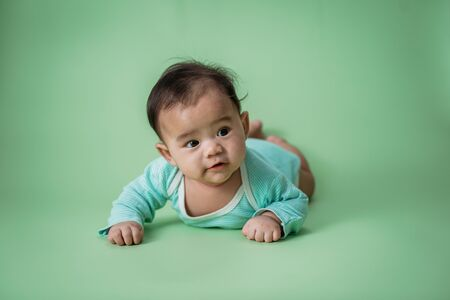 tummy time cute baby in studio