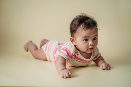 baby laying on her belly in studio