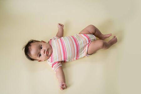 laying time cute baby in studio 版權商用圖片