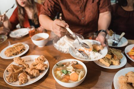 portrait of indonesian family having christmas eve dinner together at home Stock Photo