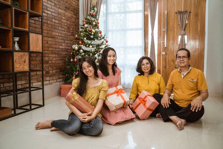 asian family celebrating christmas day together at home