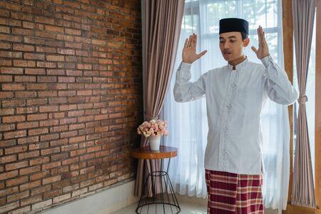 Muslim asian man praying in the house