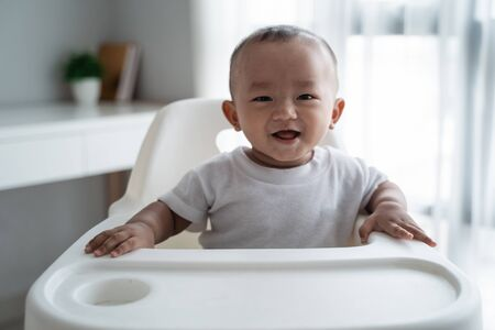 asian baby boy smiling to camera