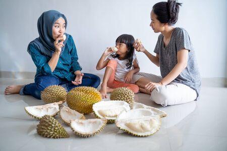family eating durian