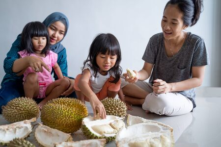 family eating durian