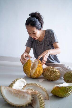 asian woman eating durian fruit Stock Photo