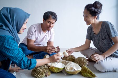 asian people eating durian Stock Photo