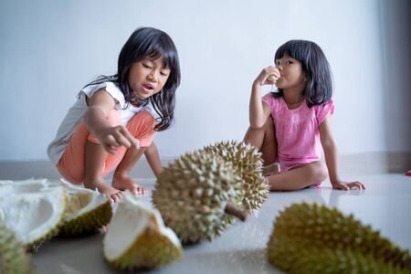 kids love to eat durian fruit Stock Photo
