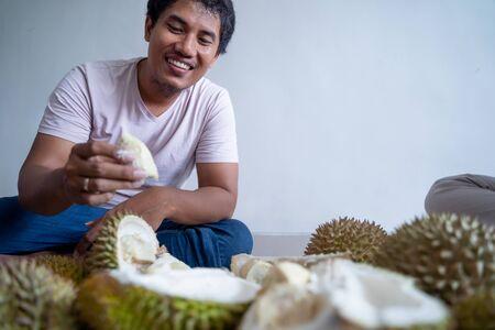 asian man enjoy eating durian fruit Stock Photo
