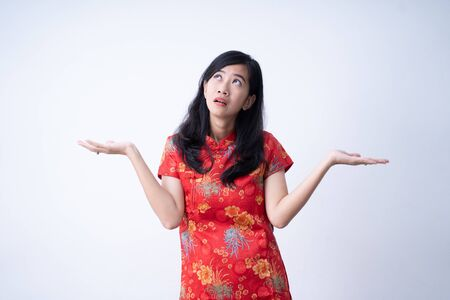 chinese woman looking up presenting