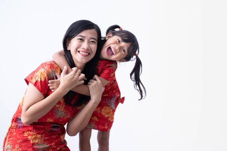 asian Chinese daughter and mother smile and hug together