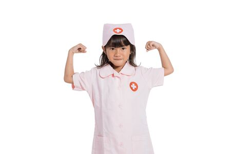 Little girl wearing a nurse uniform with showing muscles on arms