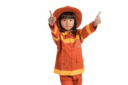 Little girl wearing firefighter uniform with thumbs up hands gesture