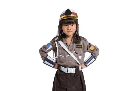 Asian little girl wearing a police uniform with two hands on her waist