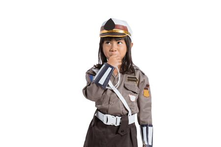 asian little girl wearing police uniform with blowing whistle