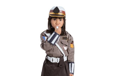 police girl wearing a uniform with blow the whistle Фото со стока