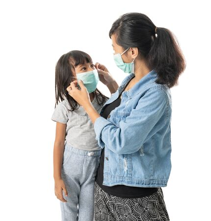 mother and daughter wearing face masks
