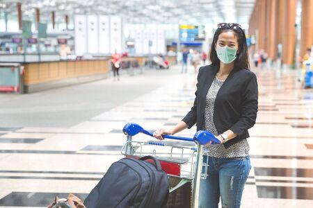 woman in international airport wear masks