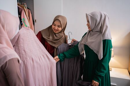 muslim woman friend picking up some dress