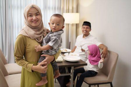 beautiful muslim family having dinner together Reklamní fotografie
