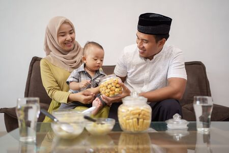 family having snack on hari raya or eid mubarak