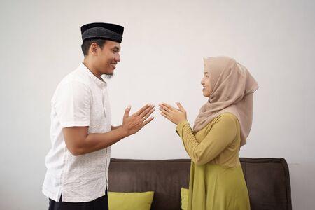 man and woman shake hand muslim touching apologizing