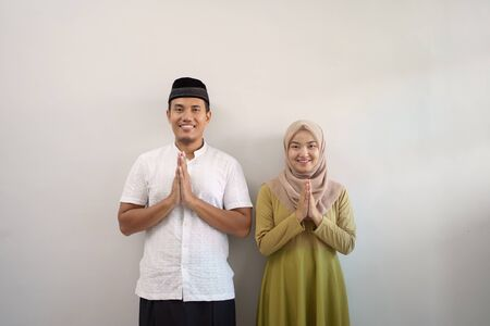 muslim couple greeting while standing